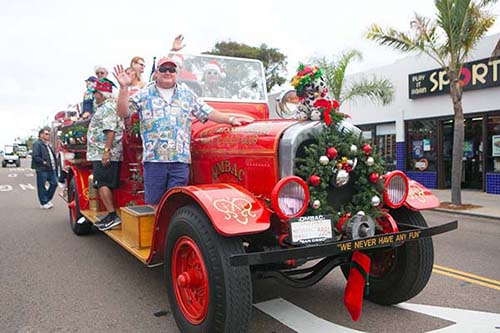 pb christmas parade fire fighters - San Diego Scenic Cycle Tours